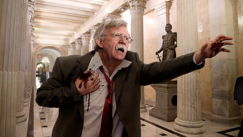 Illustration for article titled Bleeding John Bolton Stumbles Into Capitol Building Claiming That Iran Shot Him