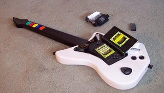 Illustration for article titled A Man-Sized Guitar Hero Portable
