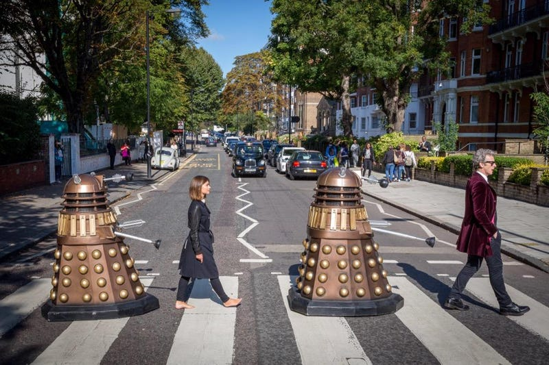 Illustration for article titled The Doctor And His Companion Cross Road To Recreate Album Cover