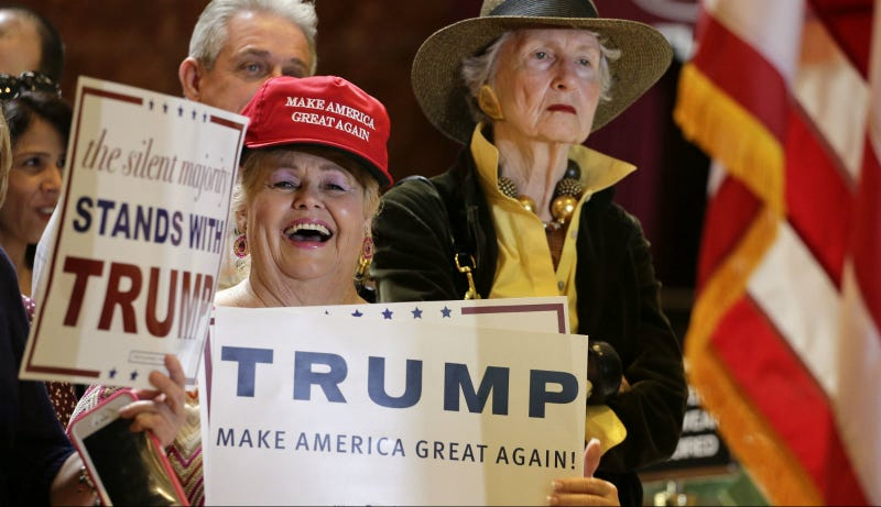"""A Trump rally attendee, September 2015, """" reacts to a joke Trump made about Russian President Vladimir Putin being a nicer person than him during a news conference in New York."""" Photo via AP"""