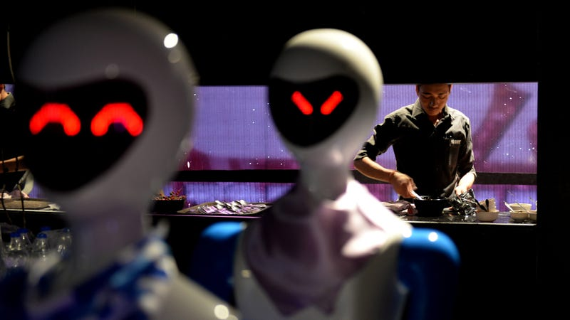 Robot's automated servers carrying dishes from the kitchen to customers. (Photo: Arun Sankar/AFP/Getty Images)
