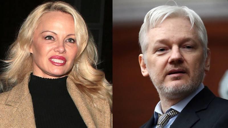 Pamela Anderson and Sexy Julian Assange (Photos: Ricky Vigil/Carl Court via Getty)