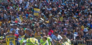 Tens of thousands listen to speeches near the Lincoln Memorial. (Paul J. Richards/AFP/Getty Images)