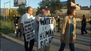 Protesters gathered July 10, 2014, in front of the Detroit company contracted by Detroit Water and Sewerage to shut off water to nonpaying customers.My Fox Detroit Screenshot