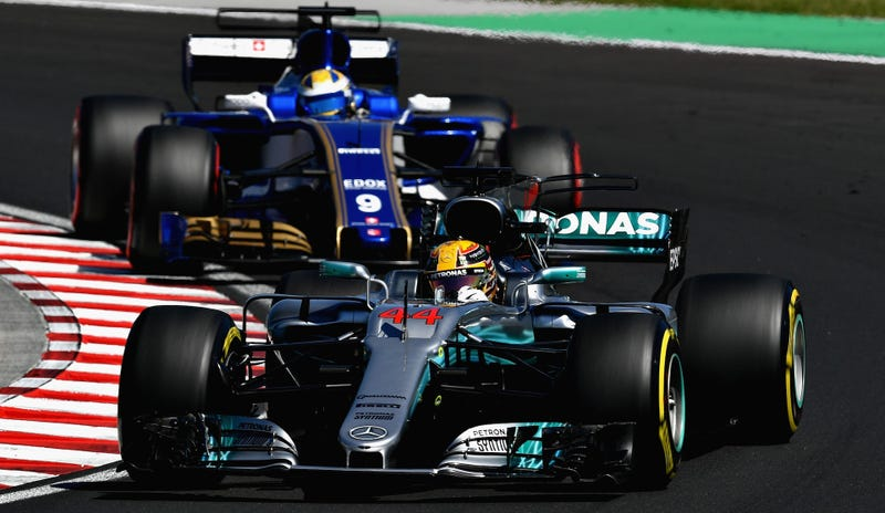 Mercedes' Lewis Hamilton and Sauber F1's Marcus Ericsson during practice for the Hungarian Grand Prix. Photo credit: Dan Mullan/Getty Images