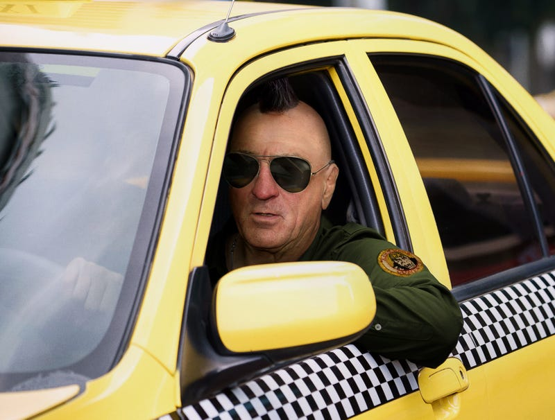 Illustration for article titled Mohawked, Aviator-Wearing Robert De Niro Idles Cab Outside Suspected Bomb-Maker's Home