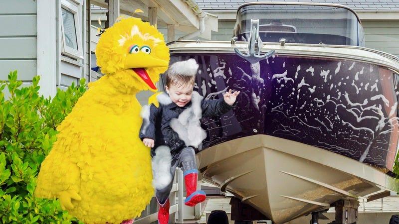 Big Bird washing his boat with a kid