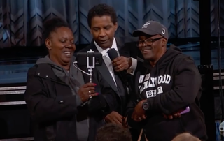 """""""Gary from Chicago"""" (right) with his fiancee, Vickie Vines, and Denzel Washington at the Oscars on Feb. 26, 2017 (Jimmy Kimmel Show via YouTube screenshot)"""