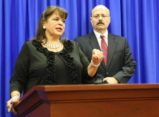 Florida State Attorney Angela Corey and Assistant State Attorney Bernie de la Rionda address the media on July 13, 2013, after a jury in Seminole, Fla., Circuit Court acquitted George Zimmerman of second-degree murder in the shooting death of Trayvon Martin.Gary W. Green-Pool/Getty Images