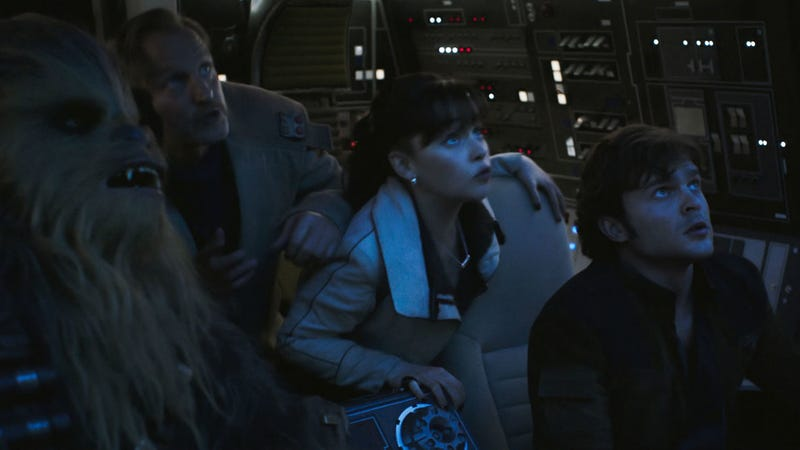 Chewie, Beckett, Qi'ra and Han look to the skies in Solo.