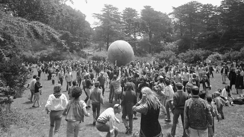 """Golden Gate Park in San Francisco, June 21, 1967. The large ball is """"painted to represent a world globe."""" Photo via AP Images."""