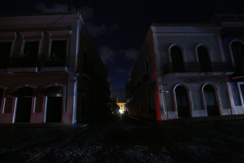 Historic buildings stand on a street lacking electricity in the Old San Juan neighborhood, on Oct. 13, 2017, in San Juan, Puerto Rico. (Mario Tama/Getty Images)