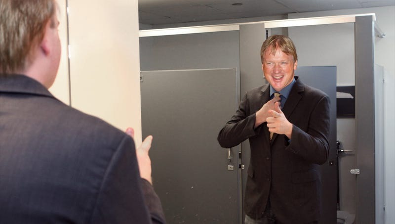 Illustration for article titled Jon Gruden Drawing Interest From Smiling Guy In Mirror