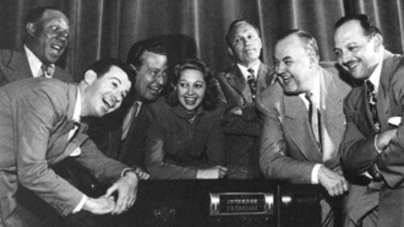 Jack Benny's cast, from left: Eddie Anderson, Dennis Day, Phil Harris, Mary Livingstone, Jack Benny, Don Wilson, Mel Blanc