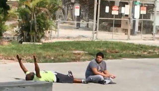 Video footage shows Charles Kinsey lying prone with his hands in the air shortly before he was shot by police in North Miami, Fla., on July 18, 2016.WPTV Screenshot