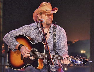 Illustration for article titled Toby Keith Struggling To Come Up With Rhyme For Ahmadinejad