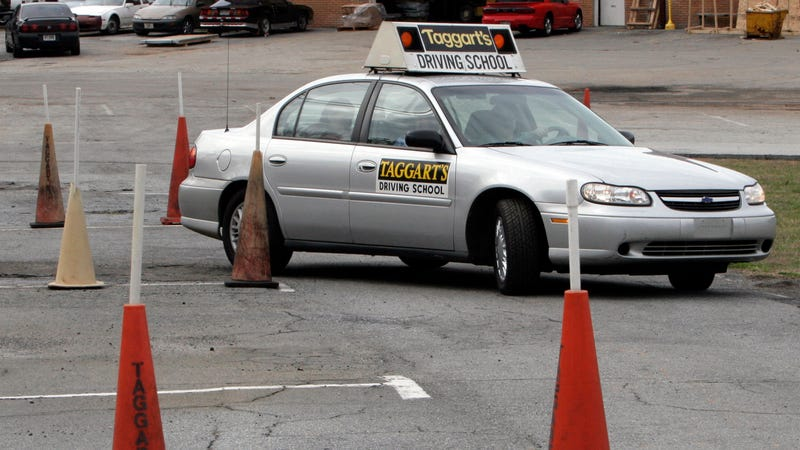 This Jan. 24, 2007 file photo shows a student going through parking cones at a driving school course in Tucker, Ga. Image credit: Gene Blythe/AP