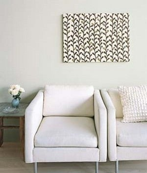 Frame fabric to inexpensively decorate your walls for Decorating walls with fabric ideas