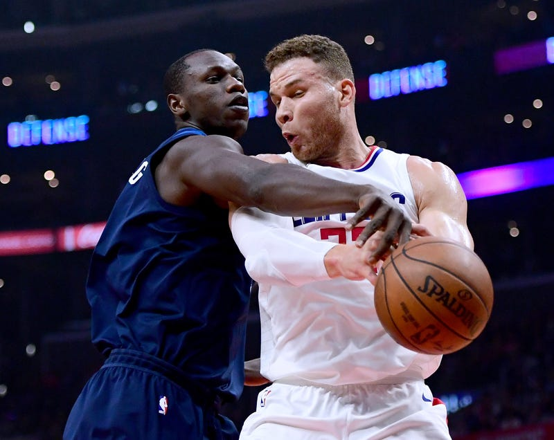 Gorgui Dieng of the Minnesota Timberwolves reaches in on Blake Griffin of the Los Angeles Clippers at Staples Center in Los Angeles on Jan. 22, 2018. (Harry How/Getty Images)