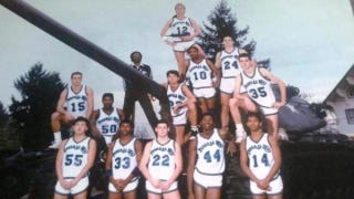 Illustration for article titled Why Does This High School Basketball Team Photo Have An Uzi And A Tank In It?