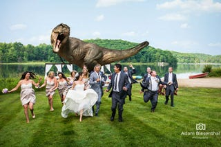 Illustration for article titled Jeff Goldblum Poses for Couple's Dinosaur Chase-Themed Wedding Photo