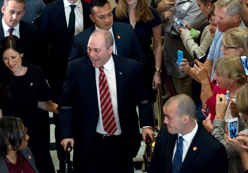 Republican House Majority Whip Steve Scalise walks with his wife, Jennifer, to his office as he leaves the House chamber in the Capitol in Washington, D.C., on Sept. 28, 2017. Scalise returned to the House more than three months after a baseball-practice shooting left him fighting for his life. (Jose Luis Magana/AP Images)