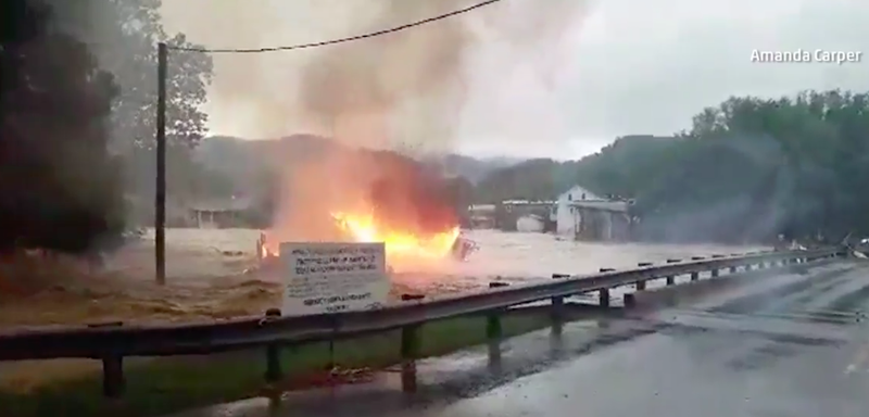 Illustration for article titled Flooding in West Virginia Is So Bad a Burning House Floated Down a Creek