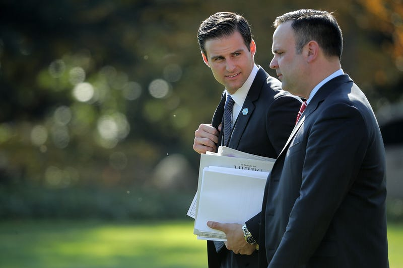 Then-personal aide to President Donald Trump John McEntee and White House Director of Social Media Dan Scavino leaving the White House on Nov. 29, 2017, in Washington, D.C.