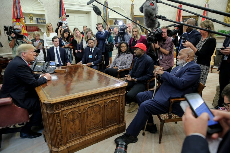 Kanye West and Jim Brown were among those sitting in the Oval Office with President Donald Trump on Thursday, Oct. 12, 2018.