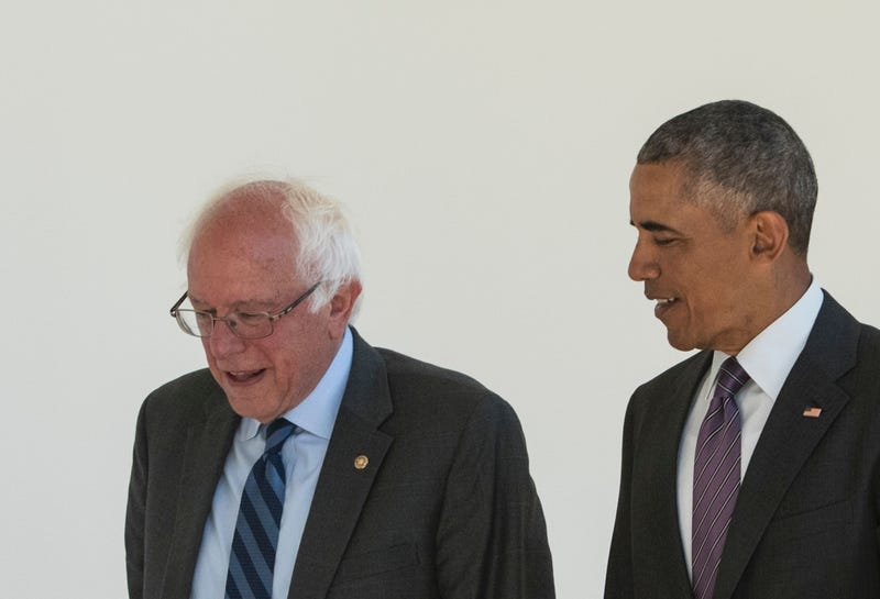 Democratic presidential candidate Bernie Sanders walks with President Barack Obama through the Colonnade for a meeting in the Oval Office on June 9, 2016, at the White House in Washington, D.C. MANDEL NGAN/AFP/Getty Images
