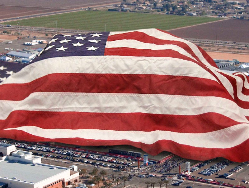Illustration for article titled Giant American Flag Draped Over Entire Stadium During National Anthem