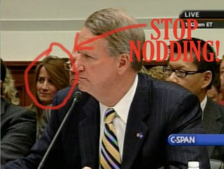 Illustration for article titled To The Woman Sitting Behind Rick Wagoner at the House Financial Services Committee Hearing...