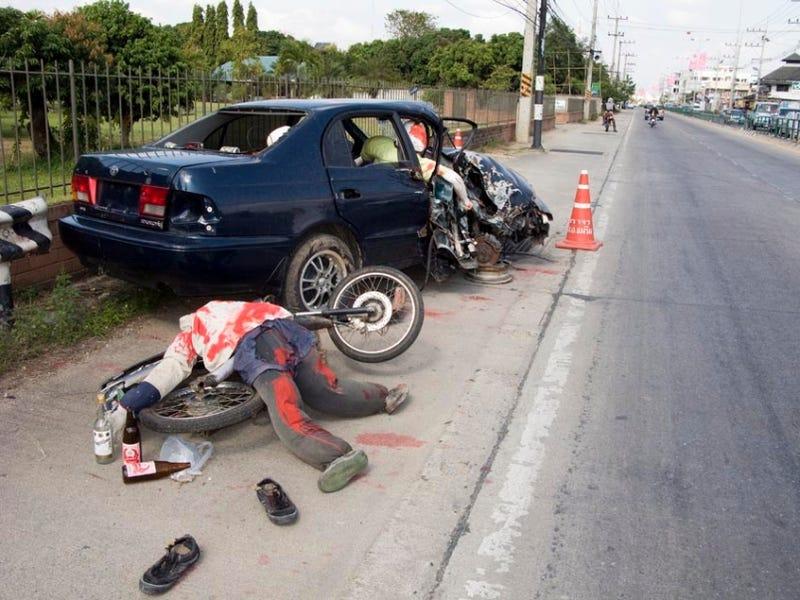 Illustration for article titled Thai Police Erect Fake Crash Sites To Deter Drunk Driving