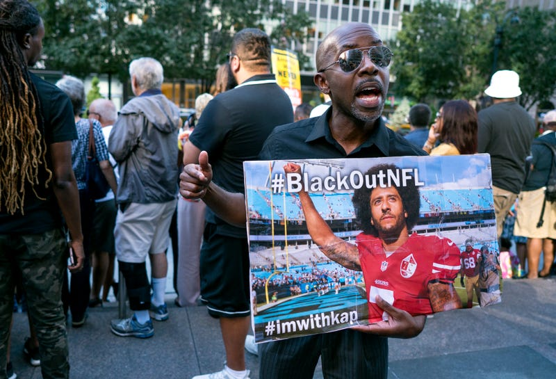 Eric Hamilton of New York City joins others gathered in support of unsigned NFL quarterback Colin Kaepernick on  Aug. 23, 2017, in front of NFL headquarters in New York City. (Craig Ruttle/AP Images)