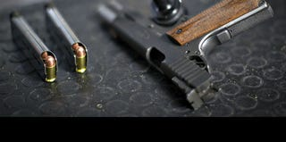 A 9mm pistol and ammunition (Andy Clark/Reuters)