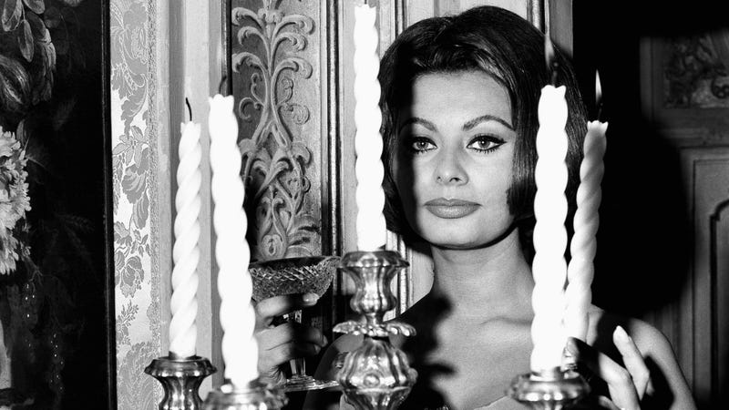 Illustration for article titled Pure Glamour Is Sophia Loren Toasting You From Behind This Terrifying Candelabra
