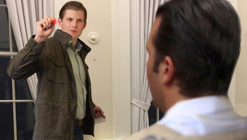 Illustration for article titled Eric Trump Aims Laser Pointer At Don Jr. While Flicking Lights On And Off To Erase Memory Of Russia Meeting