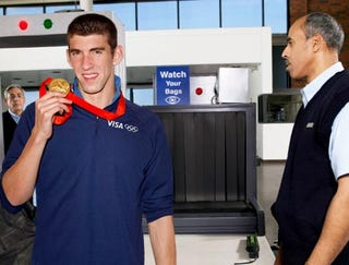 Illustration for article titled Michael Phelps Winks Mischievously After Setting Off Airport Metal Detector
