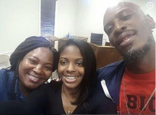 Kamiyah Mobley (center) with her birth parents, Shanara Mobley and Craig Aiken (Facebook)