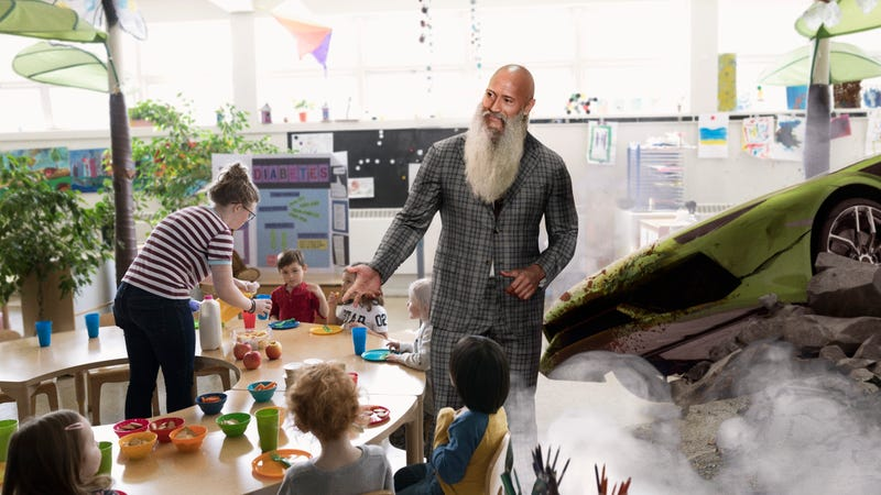 Illustration for article titled He Did Kindly Arrive! The Rock Dwayne Johnson Just BLASTED His Car Through The Wall Of This Daycare Center To Show The Toddlers His Long, Gray Wizard's Beard