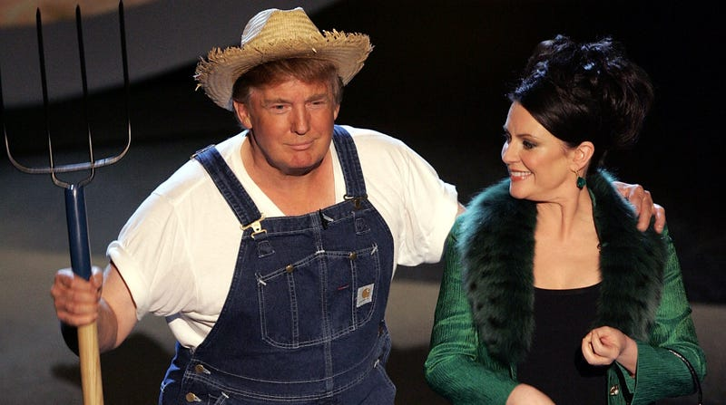 Donald Trump (L) and Actress Megan Mullally perform the Green Acres Theme onstage at the 57th Annual Emmy Awards held at the Shrine Auditorium on September 18, 2005, in Los Angeles.