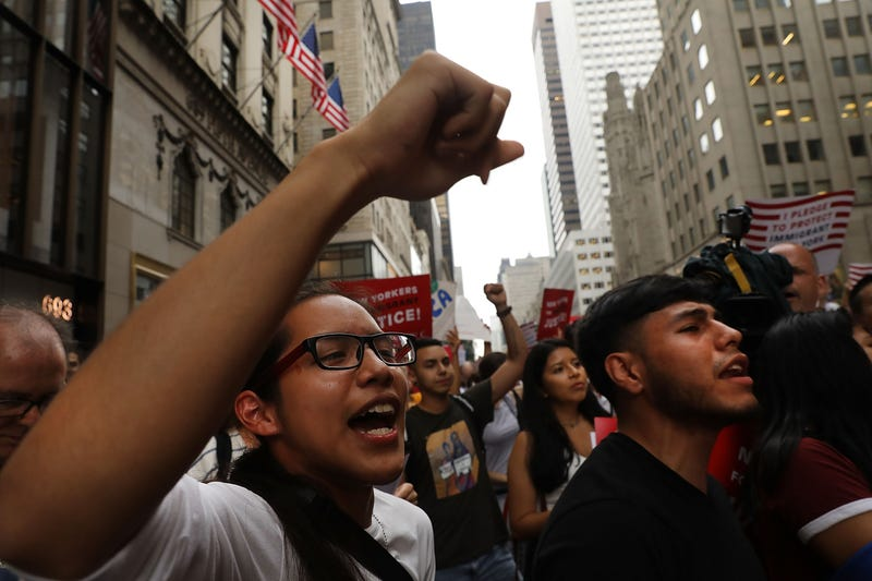 Dozens of immigration advocates and supporters attend a rally outside Trump Tower in New York City on Aug. 15, 2017.  The activists were rallying on the five-year anniversary of President Barack Obama's administrative program, Deferred Action for Childhood Arrivals, or DACA. (Spencer Platt/Getty Images)