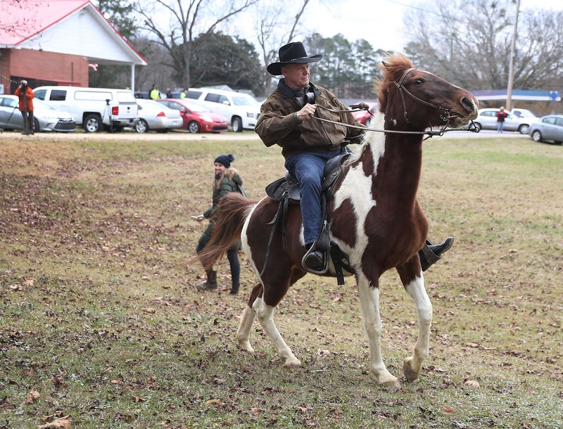 Republican senatorial candidate Roy Moore rides his horse after casting his vote at the polling location set up in the Fire Department on Dec. 12, 2017, in Gallant, Ala. (Joe Raedle/Getty Images)