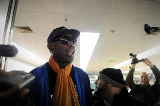 Former U.S. basketball player Dennis Rodman talks to the media upon arriving at Beijing International Airport from North Korea on Jan. 13, 2014.WANG ZHAO/AFP/Getty Images