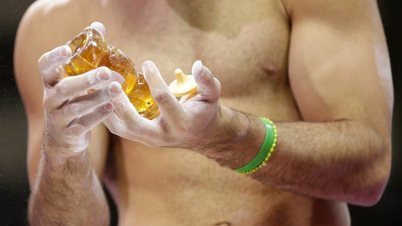 Illustration for article titled Olympic Gymnasts Use Honey, Coke, Melted Gummy Bears and Other Hand Goop to Stay on the Bars