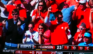 Illustration for article titled The Guy Wearing Blue In A Sea Of Clemson Orange Gives A Two-Finger Salute