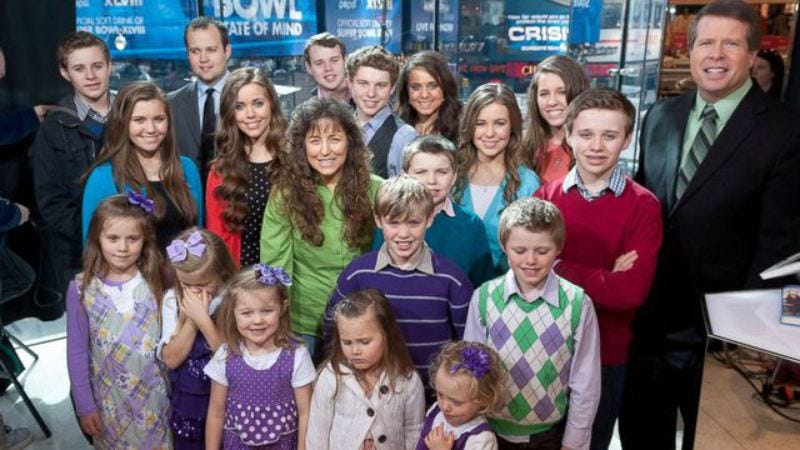 The Duggar family on the set of Extra in March 2014 (Image by: Getty Images)