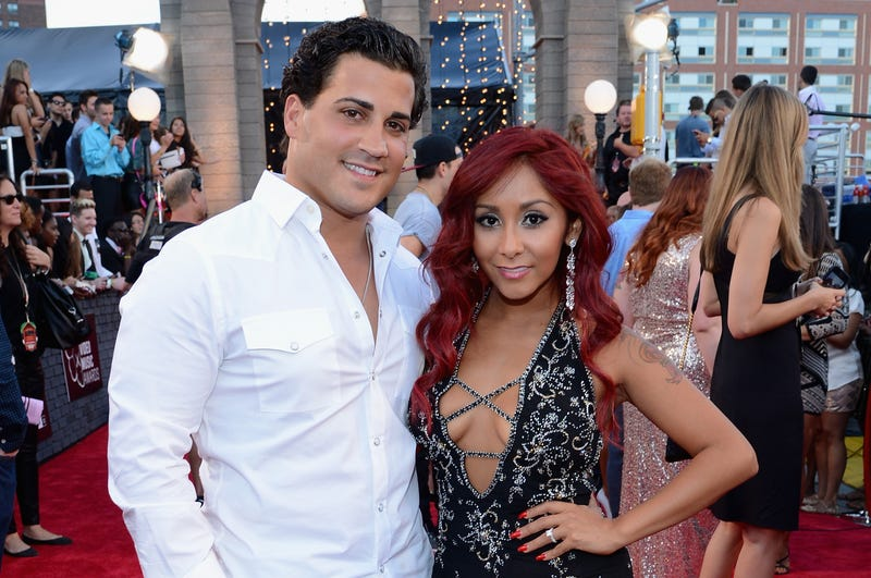 "Television personality ""Snooki"" (right) with husband Jionni LaValle at the 2013 MTV Video Music Awards at the Barclays Center on Aug. 25, 2013, in the Brooklyn borough of New York City"