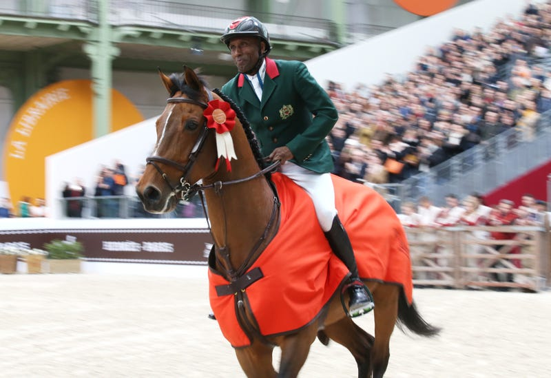 Abdelkebir Ouaddar of Morocco, riding Quickly de Kreisker, celebrates winning the Grand Prix Hermes CSI5 show jumping event on day 3 of the Saut Hermes at the Grand Palais venue in Paris on March 20, 2016.Jean Catuffe/Getty Images
