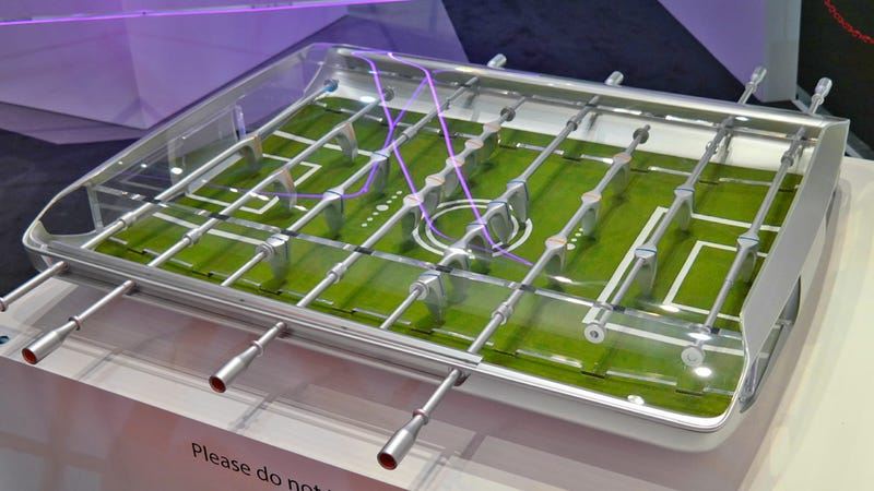 Illustration for article titled Ford Designed a Sleek Futuristic Foosball Table With Actual Grass Turf